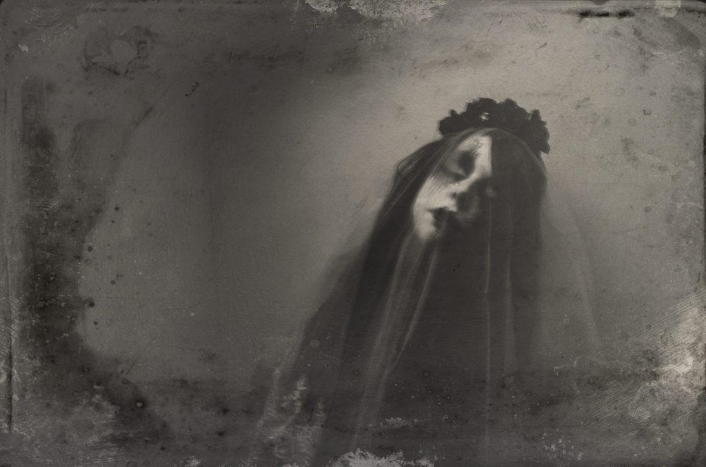 Horror wet plate portrait of woman in veil