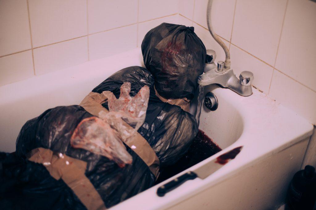 Dead body in a bath tub full of blood