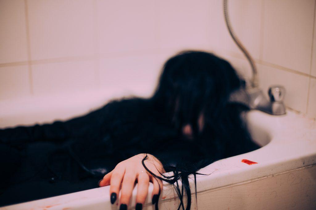 Creepy woman in a blood bath