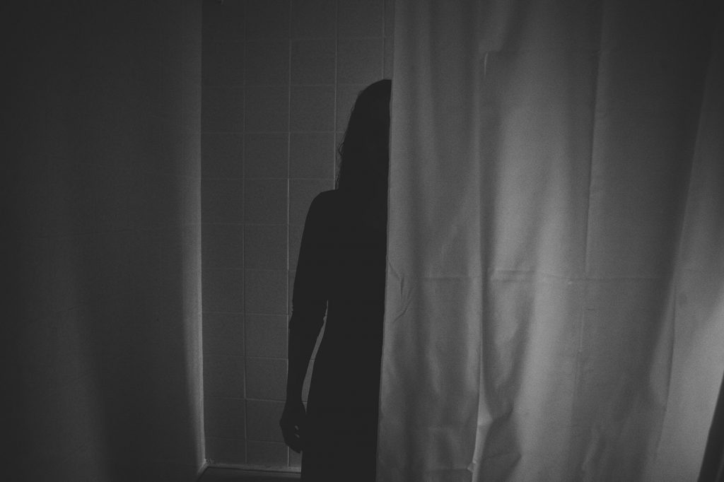 Shadow of a ghost in the shower - horror photography