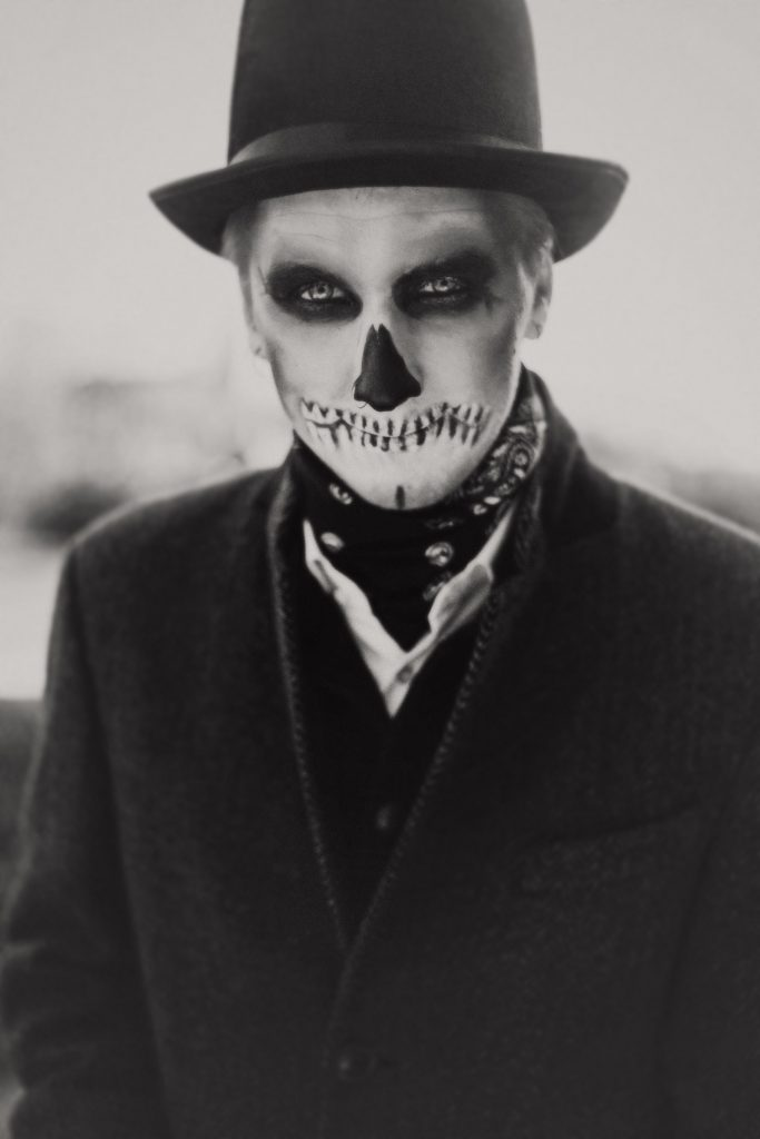 Skull face man in top hat in black and white